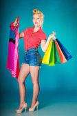 Pin-up girl buying  pink dress. — Stockfoto