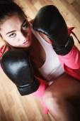 Woman in black gloves boxing — Stock Photo