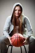 Sporty girl holding ball — Stock Photo
