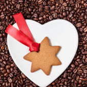 Star shaped christmas cookie and coffee beans — Stock Photo