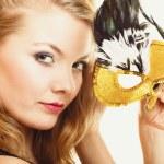Beautiful girl in carnival mask posing — Stok fotoğraf #59324375