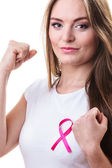 Woman in t-shirt with pink cancer ribbon — Stock Photo