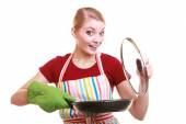 Housewife holding skillet frying pan — Stock Photo