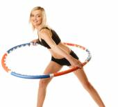 Girl doing exercise with hula hoop. — Stockfoto