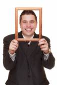 Business man framing his face — Stock Photo