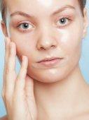 Girl woman in facial peel off mask. Skin care. — Stock Photo