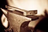 Tools- hammer on blacksmith anvil — Stock Photo
