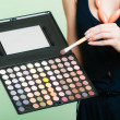 Woman holds makeup professional palette and brush — ストック写真 #60803007