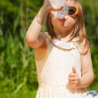 Little thirsty girl child drink water from plastic bottle, outdoor — Stock Photo #60867181
