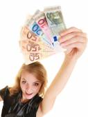Rich woman showing euro currency money banknotes. — Stock Photo