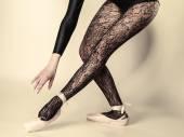 Female legs dancer in ballet shoes — Stock Photo