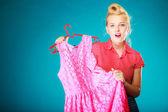 Pinup girl woman buying pink dress. Sale — Stock Photo