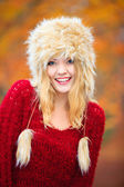 Woman in winter clothing fur cap outdoor — Stock Photo