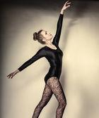 Graceful woman dancing in studio — Stock Photo