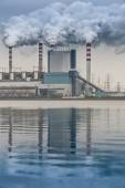 Smoke from chimneys of power plant — Stock Photo