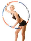 Girl doing exercise with hula hoop. — Stock Photo
