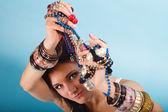Girl with plenty of jewellery smiling — Stock Photo