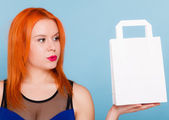 Woman holding paper shopping bag — Stock Photo