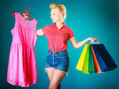 Girl with shopping bags buying clothes — Stock Photo