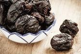 Prunes in bowl — Stock Photo
