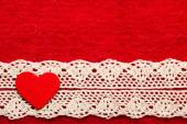 Heart on red cloth — Stock Photo