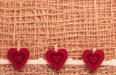 Red hearts on  cloth background — Stock Photo