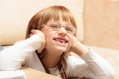 Child sticking tongue at home — Stock Photo