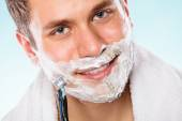Handsome man shaving — Stock Photo