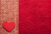 Heart on red cloth background — Stockfoto