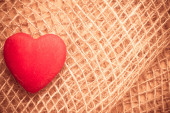 Red heart on  cloth background — Stock Photo