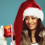Girl holds red mug — Stock Photo #62303687