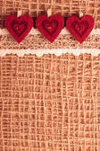 Hearts on cloth background — Stockfoto