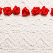 Silk roses on white cloth — Stock Photo #62388971