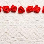 Silk roses on white cloth — Stock Photo #62388971