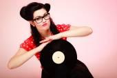 Pinup girl holding vinyl record — Stock Photo