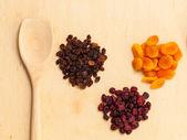 Raisins, apricots, cranberries — Stock Photo
