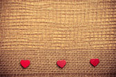 Hearts on cloth background — Stock Photo
