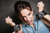Woman showing handcuffs — Stock Photo