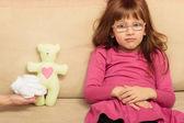 Girl sitting on sofa — Stock Photo