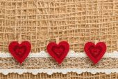 Red hearts on cloth — Stockfoto