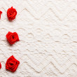 Red silk roses on lace — Stock Photo #63247309