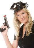 Policewoman cop holding gun — Stock Photo