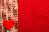 Heart on red cloth — Stockfoto