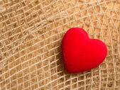 Red heart on  cloth — Stockfoto