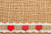 Red hearts on  cloth — Stock Photo