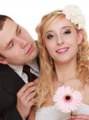 Happy bride and groom smiling — Stock Photo