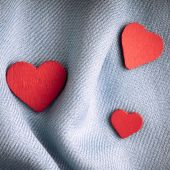 Red hearts on gray cloth — Stock Photo
