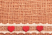 Red hearts on cloth — Foto de Stock