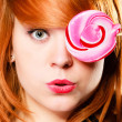 Girl holding pink lollipop — Stock Photo #64555117