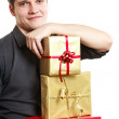 Young man holding gift boxes — Stock Photo #64555483